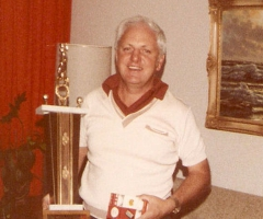 Dad and golf trophy